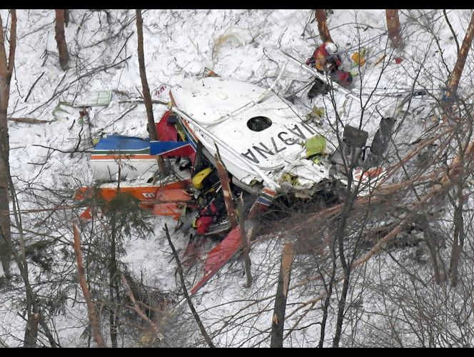 TOKYO (AP) — A rescue helicopter carrying nine people crashed in snow-covered mountains in central Japan during a training flight Sunday, leaving at least three people dead and four missing.