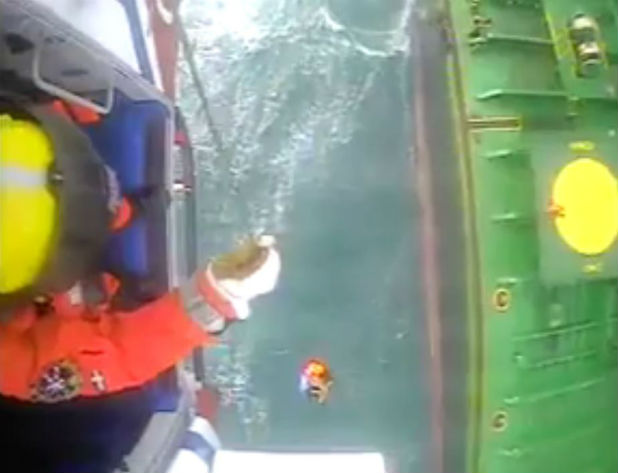 The coastguard has released dramatic footage from its rescue helicopter called to help an injured seaman in 60mph winds off Cornwall.